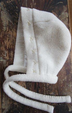 White woolen bonnet baby
